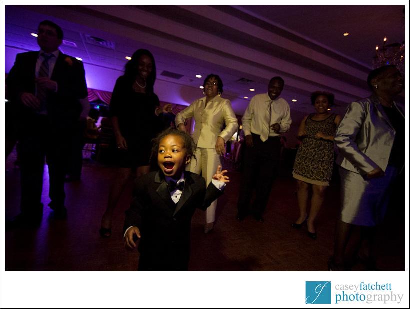kid dancing at wedding reception