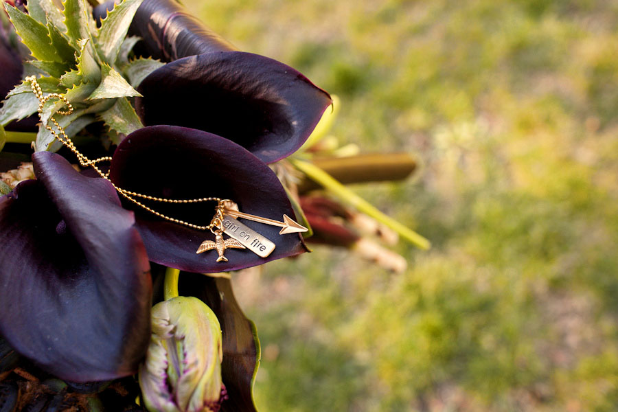 Hunger Games necklace and wedding bouquet