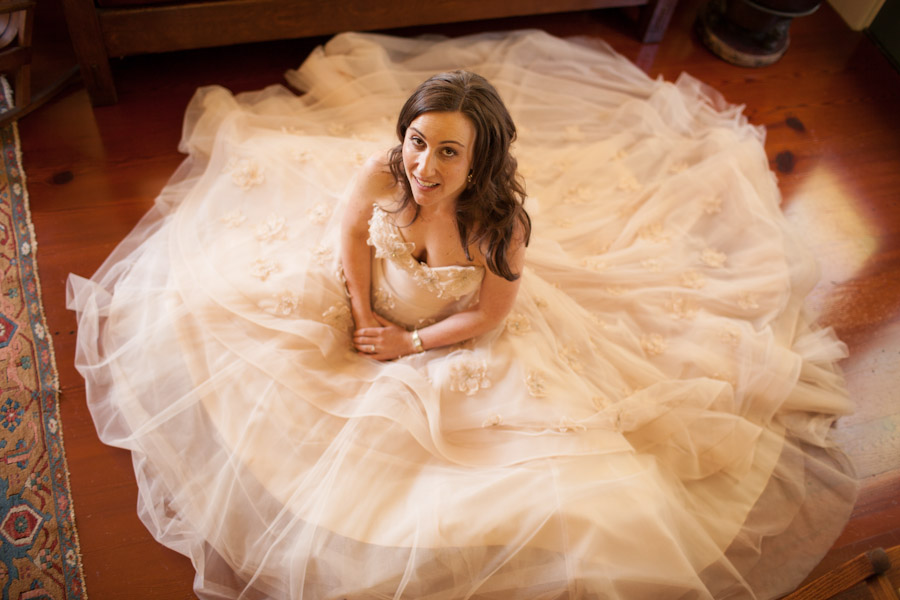 bride getting ready in gown