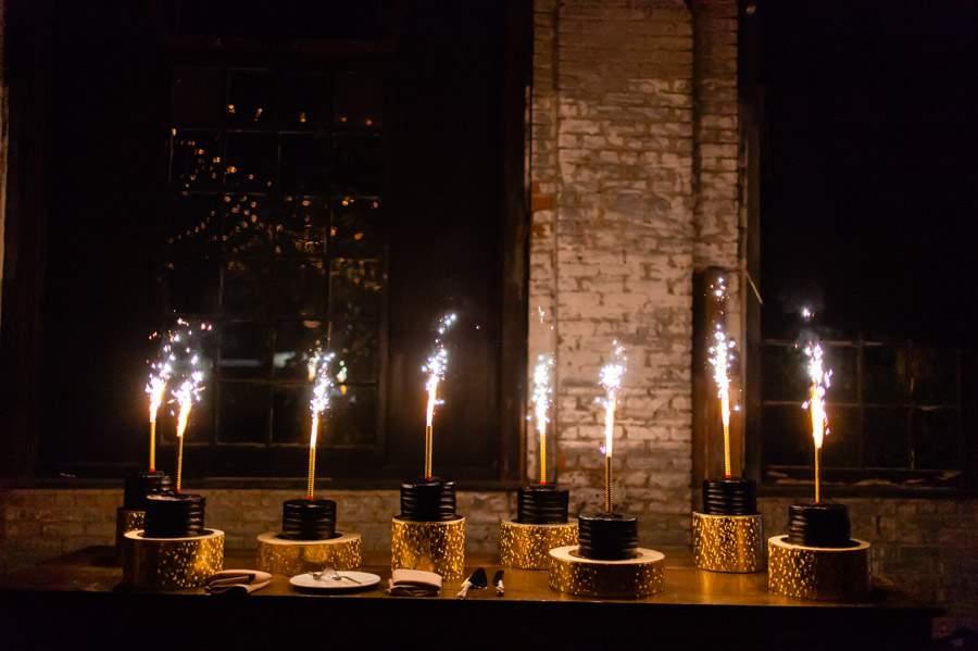 Wedding cake sparklers - photos by Casey Fatchett