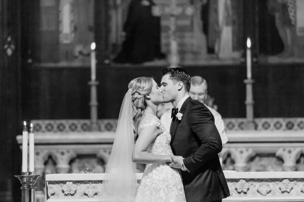 bride and groom first kiss wedding ceremony