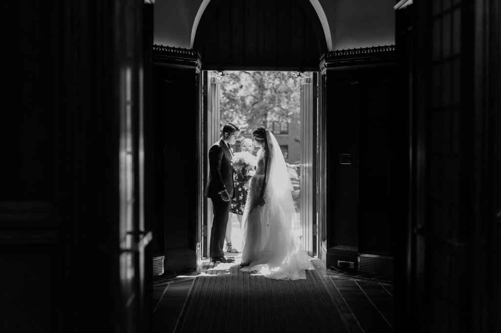 church wedding ceremony bride and groom private moment black and white
