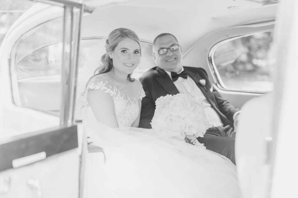 bride with dad in limousine